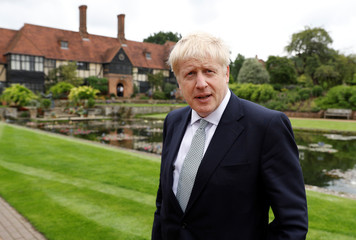 Boris Johnson, a leadership candidate for Britain's Conservative Party, looks on during his visit at Wisley Garden Centre in Surrey