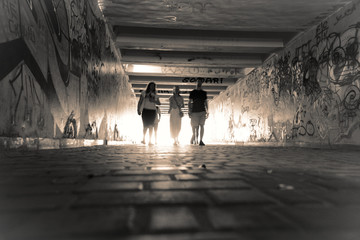 Pedestrian crossing tunnel, Dark and long underground passage with light Wall mural