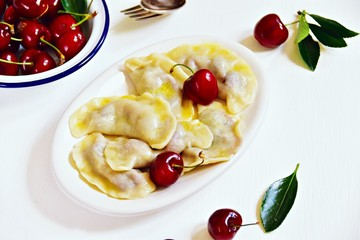 Pierogi aka vareniki with cherry and butter