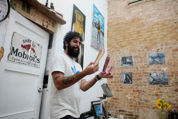 Wilfredo Santos shows handcrafted dildos he bought in Havana