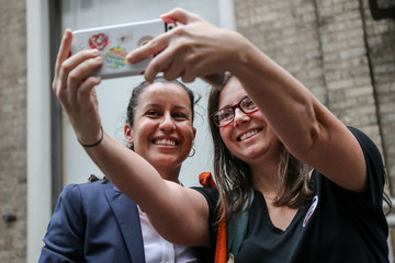 Queens D.A. candidate Tiffany Caban takes a picture with a volunteer in the Queens borough of New York City