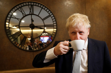 Boris Johnson, a leadership candidate for Britain's Conservative Party, visits a tea shop in Oxshott