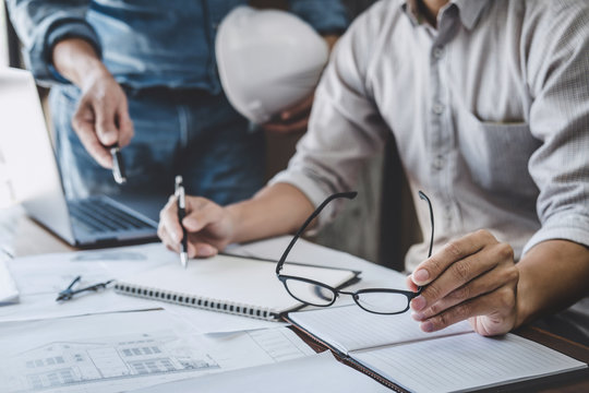 Construction and structure concept of Engineer or architect meeting for project working with partner and engineering tools on model building and blueprint in working site, contract for both companies