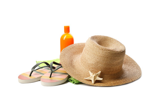 Different stylish beach accessories on white background