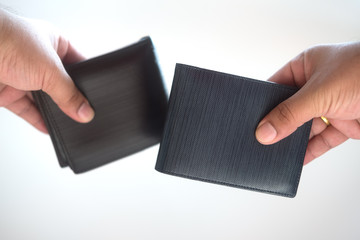 Men leather wallet in hand on white background.