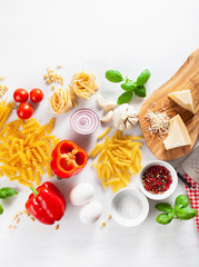 Wall Mural - ingredients for italian cousine flat lay, pasta spaghetti penne fusilli tomato oil vegetables