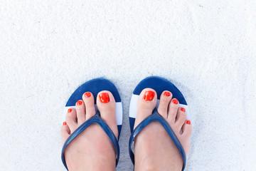 Female feet on sand