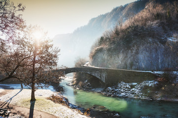 Spoed Fotobehang Olijf Misty frosty morning in Cluses village, Rhone-alpes, France. Beautiful winter landscape