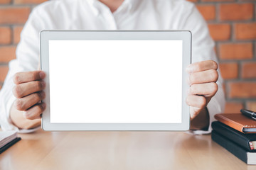 Tablet horizontal screen mockup, Image of Young man holding digital tablet showing copy space, switching on to start his work with a clean screen and blank space for text Wall mural