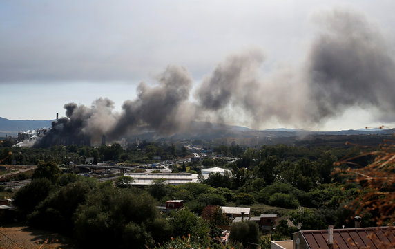 A cloud of smoke is seen during a fire in a chemical factory in San Roque
