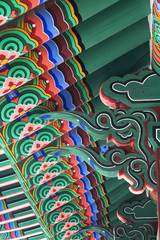 Dancheong, traditional Korean multicolored paintwork on wooden roof .