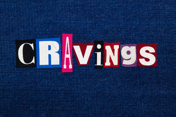 CRAVINGS word text collage, multi colored fabric on blue denim, uncontrollable urge concept, horizontal aspect