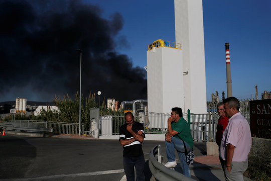Cloud of smoke is seen during a fire in a chemical factory in San Roque