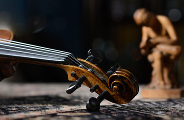 detail violin - still life with a wooden figure, due to the character contains grain / noise ratio and enhanced details