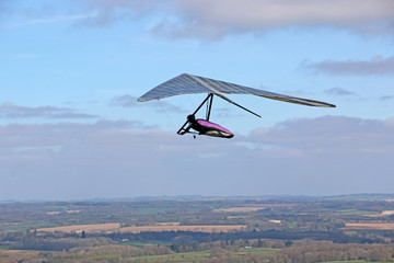 Wall Mural - Hang glider flying at Combe Gibbet