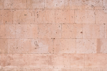 Textured sandstone wall for background and texture
