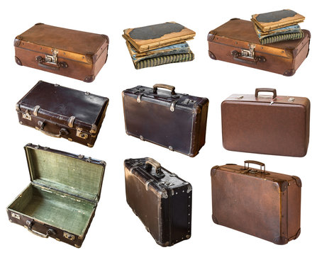 Old shabby vintage suitcases and books isolated on white background. Retro style