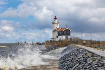 The lighthouse of Marken, a small island in the Markermeer in the Netherlands on a stormy day.