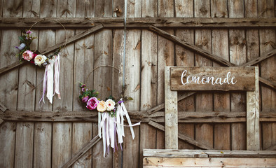 Empty wooden lemonade stand box. Rustic wedding inspiration background.