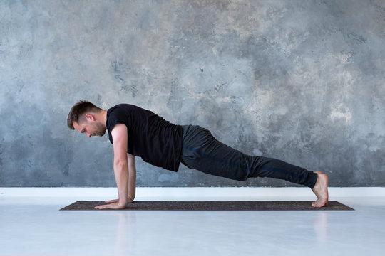Sport caucasian young man doing full plank.