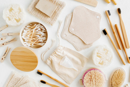 Zero waste supplies for personal hygiene. Eco Soap, bamboo toothbrush, reusable cloth menstrual pads, natural wooden brush. Sustainable lifestyle. Plastic free concept.