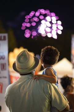 Father and Son watching fireworks