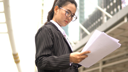 Wall Mural - Business woman read document office executive work.