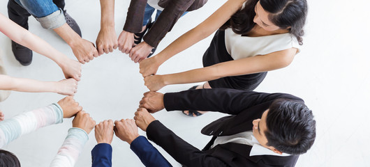 Creative team meeting hands synergy brainstorm business man woman in circle top view on white background. Support teamwork acquisition together international diversity harmony people concept banner