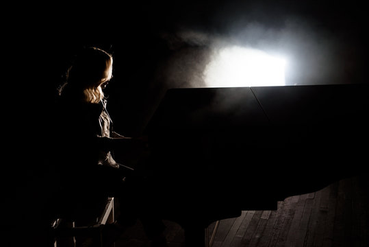 Pianist musician piano music playing. Musical instrument grand piano with woman performer