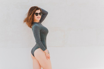Woman in lurex combidress or bodysuit, concept of fashionable clothes