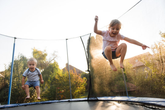 Kids jumping high on trampoline