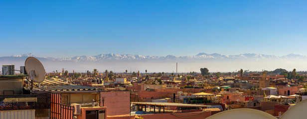 Panorama of Marrakech city skyline with Atlas mountains in the background Wall mural