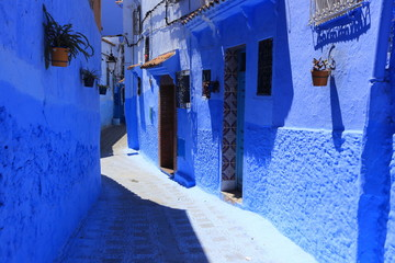 Blue street walls of the popular city of Morocco, Chefchaouen. Traditional moroccan architectural details.