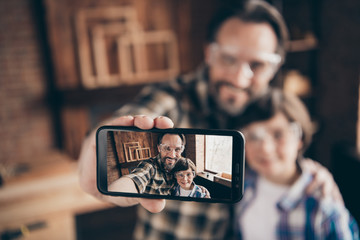 Close up photo cute attractive people content cheerful funny funky fun spend free time make photo video call device glasses goggles protective brunet hair checkered shirt beard home workplace