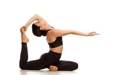 Young yoga woman doing yoga mermaid pose on white background