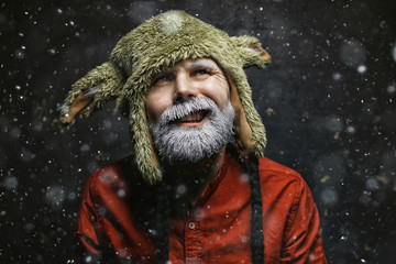 brutal hipster with a gray beard / Christmas winter portrait brutal santa claus, modern trendy guy