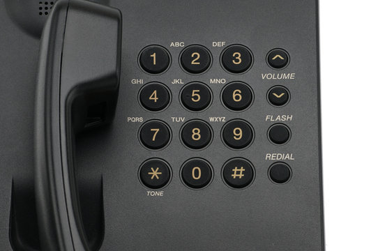 Classic wired telephone on a white background