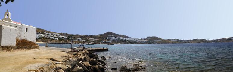 beautiful sunny bay of Saint Ioannis Chapel (Agios Ioannis) on the peninsula of Diakoftis in Mykonos (Greece), island of Cyclades, in the heart of the Aegean Sea,