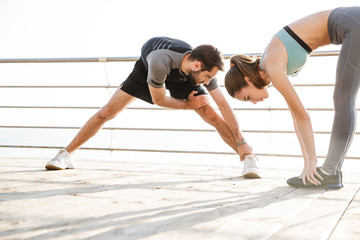Attractive sporty young fitness couple Wall mural