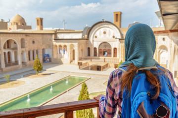 Female tourist enjoying view of traditional Iranian courtyard