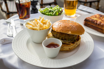 Hamburger and chips served in a French cafe