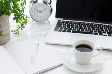 Coffee Open Laptop And Classic Alarm Clock On Desk