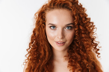 Portrait of an attractive woman with long curly red hair