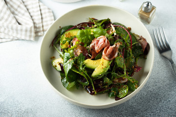 Healthy green salad with ham and avocado