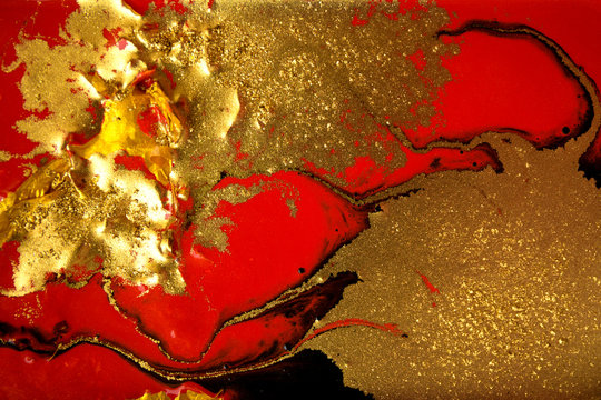 Red and gold marbling pattern. Golden marble liquid texture.