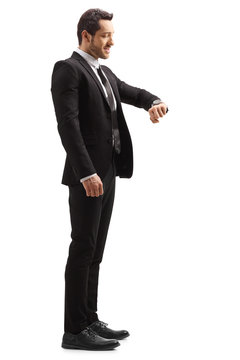 Businessman in a suit looking at his wrist watch
