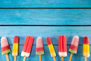 Ice cream stick placed on a blue vintage wooden