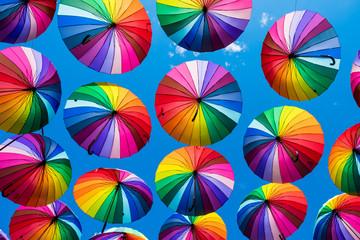 Many colorful umbrellas. Rainbow gay pride protection Wall mural