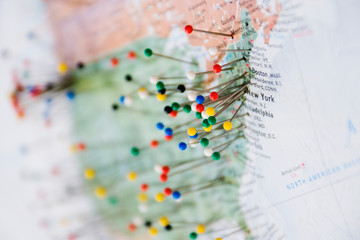 Pins in Map of US and Canadian Border