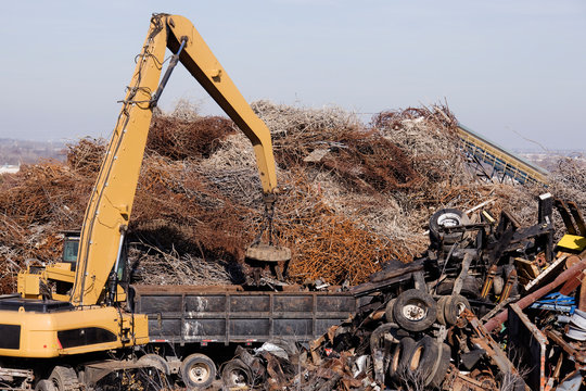 Excavator Moving Scrap Metal with Electro Magnet